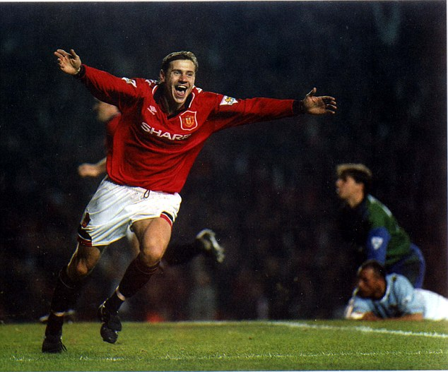 PKT4524-328523 ANDREI KANCHELSKIS FOOTBALLER 1994 Manchester United 5 Manchester City 0 Russian Rules It: Andrei Kanchelskis turns in delight after his second goal.