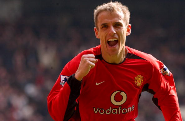 MANCHESTER, ENGLAND - APRIL 19: Phil Neville celebrates after team mate Paul Scholes scores during the FA Barclaycard Premiership match between Manchester United v Blackburn Rovers at Old Trafford on April 16, 2003 in Manchester, England. (Photo by Matthew Peters/Manchester United via Getty Images)